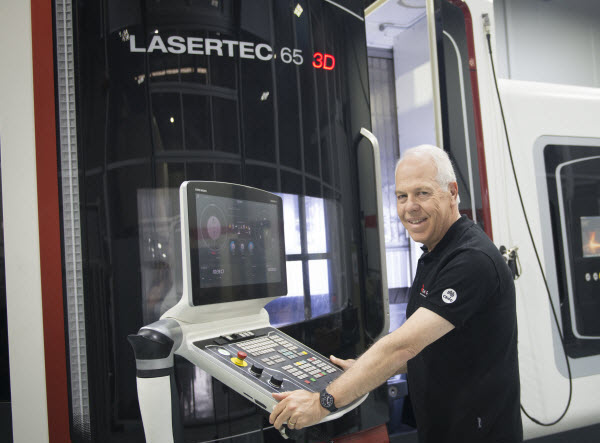 Man in front of Lasertec 65