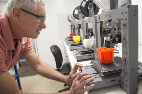 Man checking the molding machine