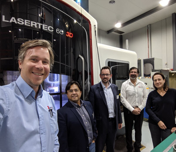 Team taking a picture with the Lasertec65 equipment