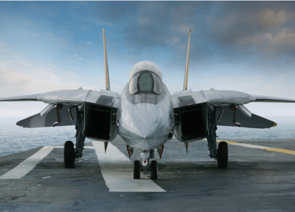 F-14 jet fighter on an aircraft carrier deck