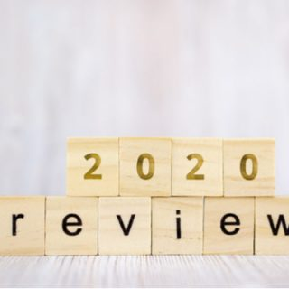 The word review on wooden cube block