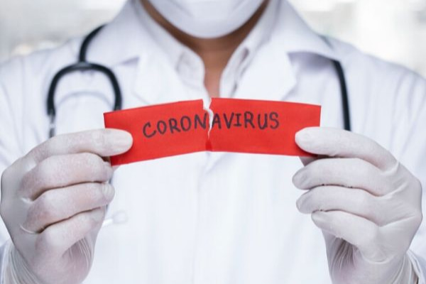 Doctor holding a paper with word of Corona virus