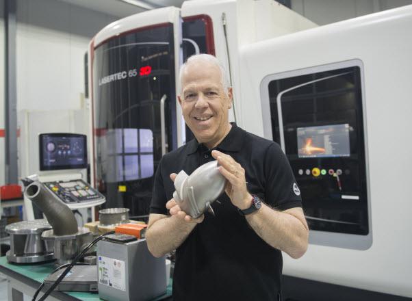 A man holding a tool inside a laboratory